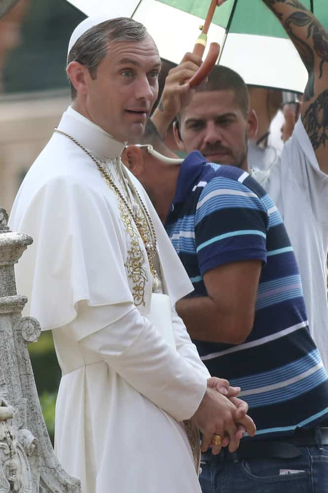 "Jude Law pulled off the salt and pepper hair color while filming some scenes for the movie ""The Young Pope"" in the gardens of Villa Pamphili in 2015."