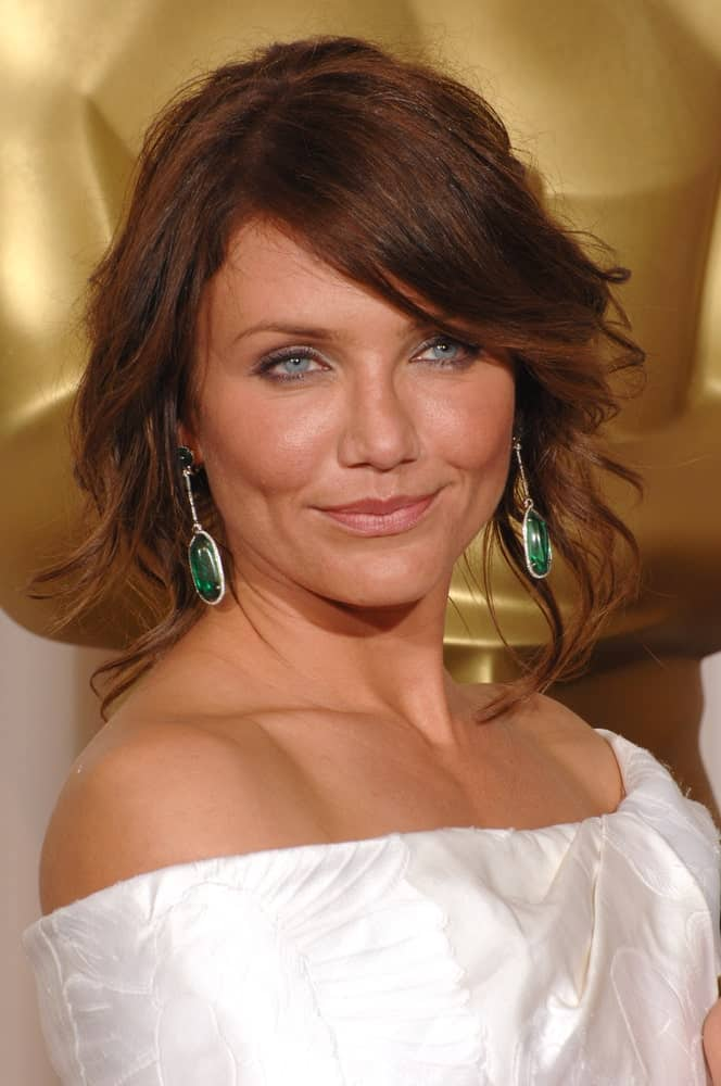 Cameron Diaz complemented her pearly white dress with a curly auburn bob hairstyle at the 79th Annual Academy Awards at the Kodak Theatre in Hollywood last February 26, 2007.