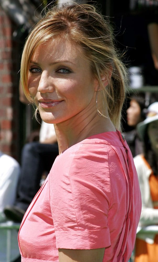 Cameron Diaz wore a casual messy ponytail to match her sweet pink dress at the Los Angeles premiere of 'Shrek 3' held at the Mann Village Theater in Westwood last May 6, 2007.