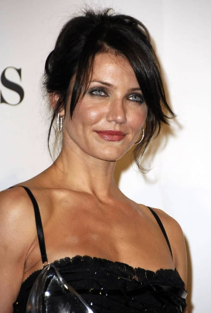 Cameron Diaz had raven dyed hair in a messy half-up hairstyle in the press room for The 33rd Annual People's Choice Awards held at The Shrine Auditorium in Los Angeles last January 09, 2007.