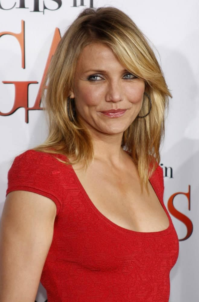 Cameron Diaz looked stunning in red at the World premiere of 'What Happens in Vegas' held at the Mann Village Theater in Westwood last May 1, 2008. She had a simple make up and her hair was highlighted with side-swept bangs.