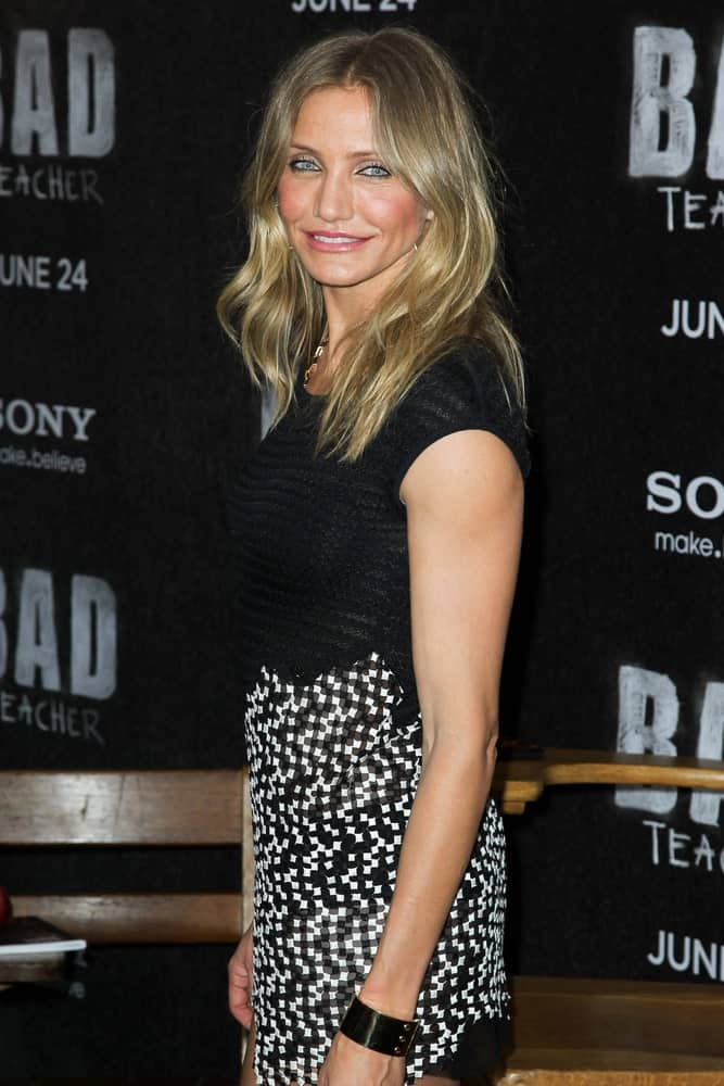 Cameron Diaz sported a sexy black and white dress that perfectly complements her sandy blond hair that is tousled and loose with subtle highlights when she attended the premiere of