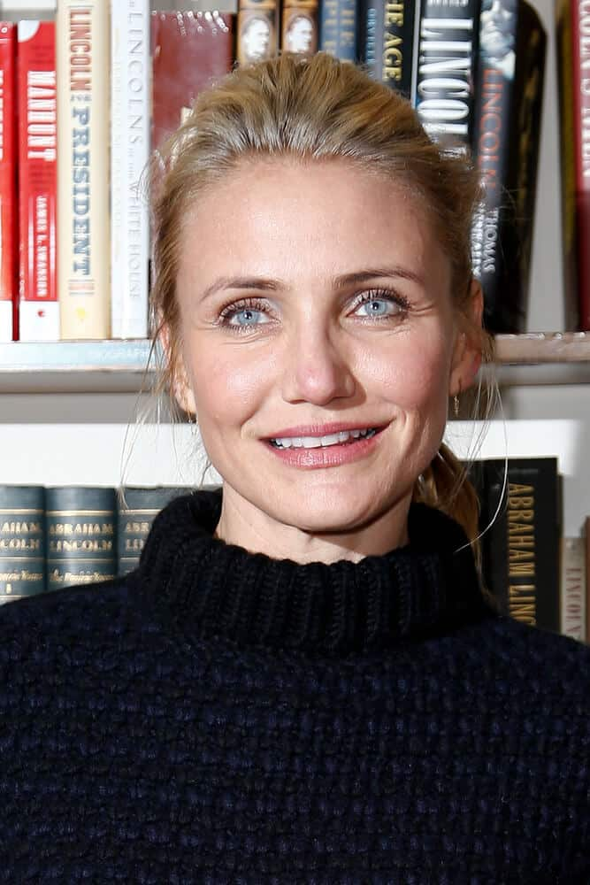 Cameron Diaz is quite iconic for her carefree hairstyles like this messy ponytail she wore last January 13, 2014 for her book signing in The Book Revenue, NYC.