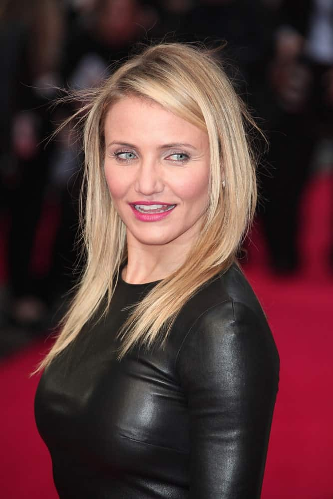 Cameron Diaz wore a sexy form-fitting black leather outfit when she attended the UK Gala premiere of 'The Other Woman' at The Curzon Mayfair on April 2, 2014 in London, England. She paired this with her loose and tousled blond hairstyle.