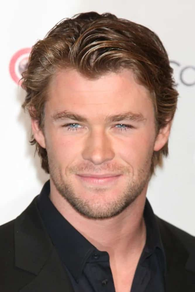 Chris Hemsworth attended the CinemaCon Convention Awards Gala Press Room in 2010 wearing his tousled side-swiped medium-length hair with a reddish brown tone.