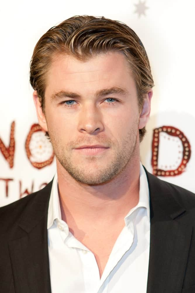 Australian actor Chris Hemsworth was at the Nomad Two Worlds Los Angeles debut gala at 59 Pier Studios West last February 22, 2011 in Santa Monica. He had a wet look to his slick side-parted hair complemented by his five o'clock shadow.