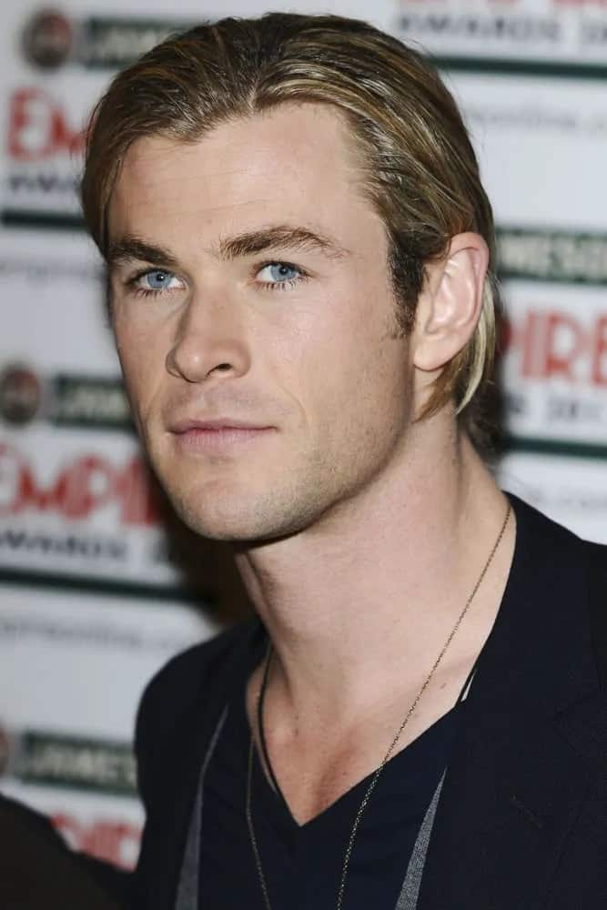 Chris Hemsworth was in the press room at the Empire Film Awards 2012. He was wearing a smart casual ensemble to pair his long side-swept hairstyle with highlights.