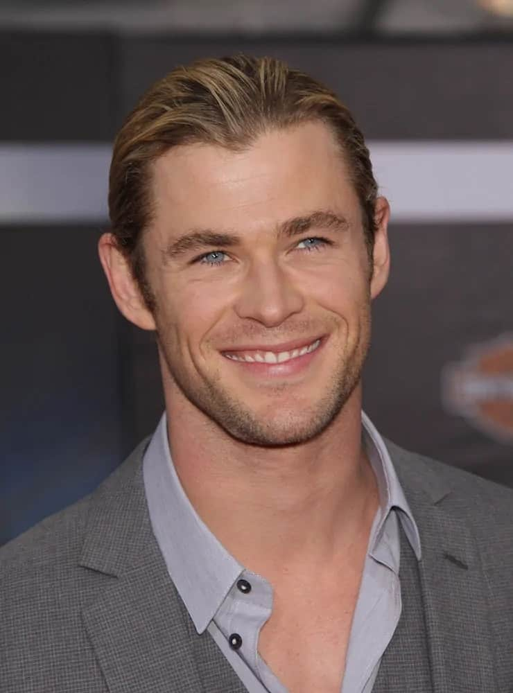 Chris Hemsworth wore a sexy man bun matched with a carefree gray detailed suit during the 2012 world premiere of The Avengers.