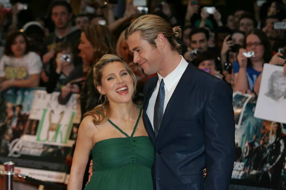 Elsa Pataky & Chris Hemsworth attended the Avengers Assemble - UK film premiere at the Vue Westfield last April 19, 2012 in London. Hemsworth was in a dark blue slick suit and has his long dirty blond hair in a man bun.