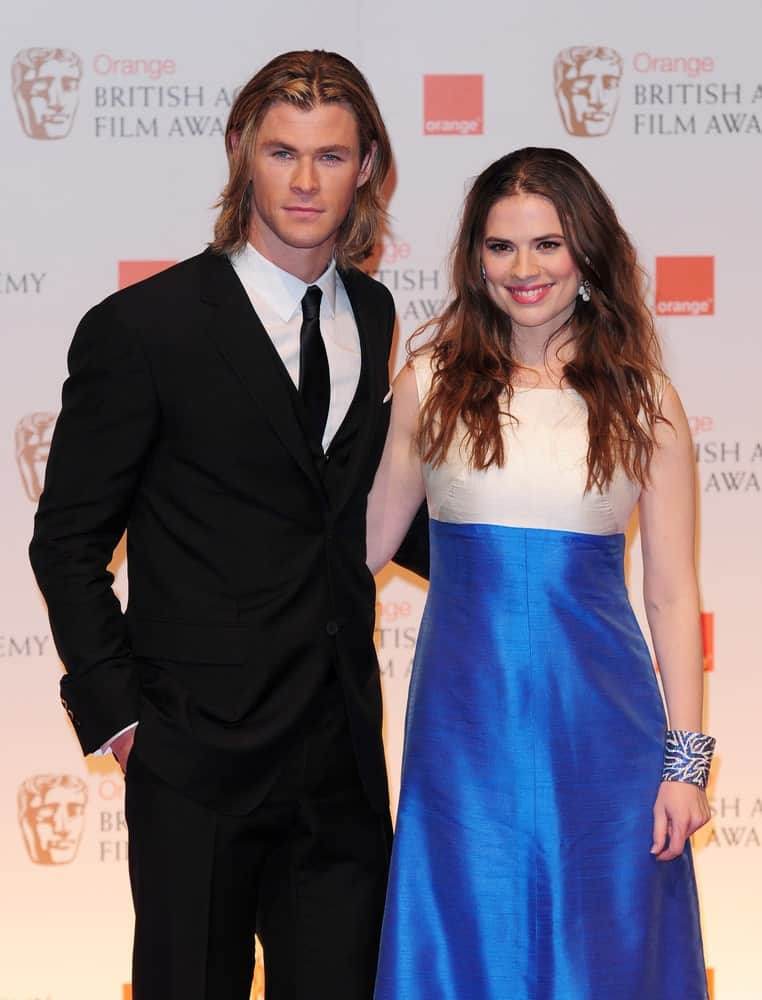 Chris Hemsworth and Hayley Atwell were in The Winners Room at the 2012 BAFTA's, Royal Opera House Covent Garden, London last February 12, 2012. Hemsworth was in his classic black suit to match his long and layered loose blond hair.