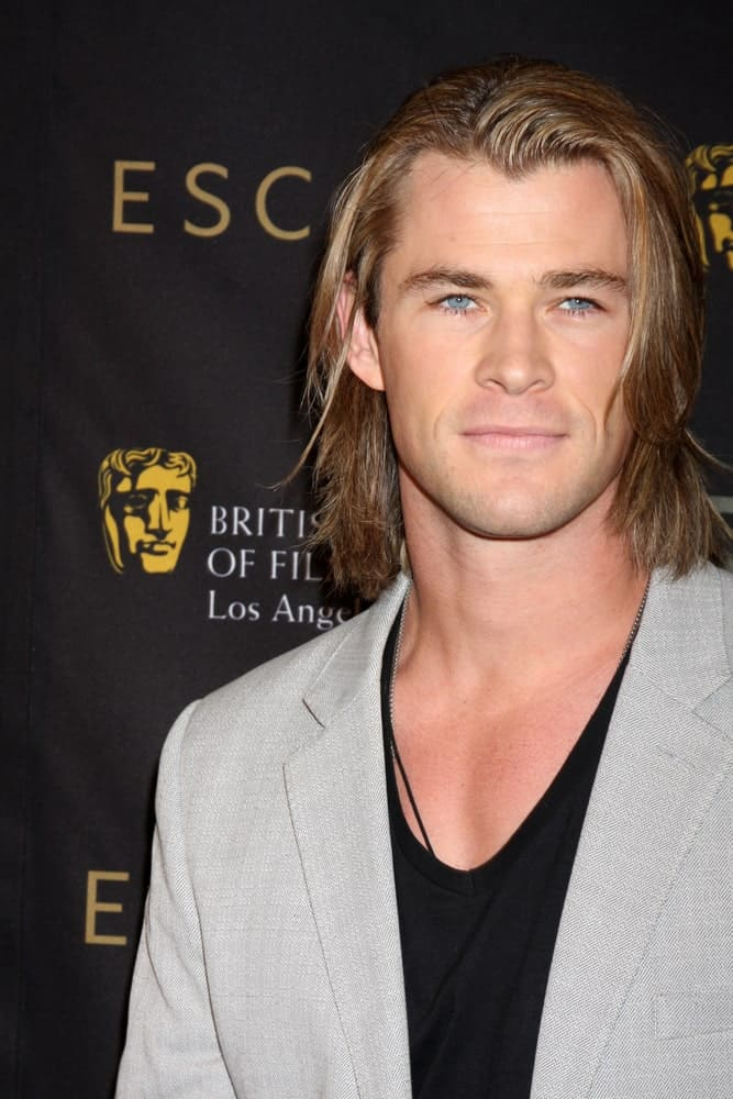 Chris Hemsworth had his long blond hair on the loose when he arrived at the BAFTA Award Season Tea Party 2012 at Four Seasons Hotel last January 14, 2012 in Beverly Hills.