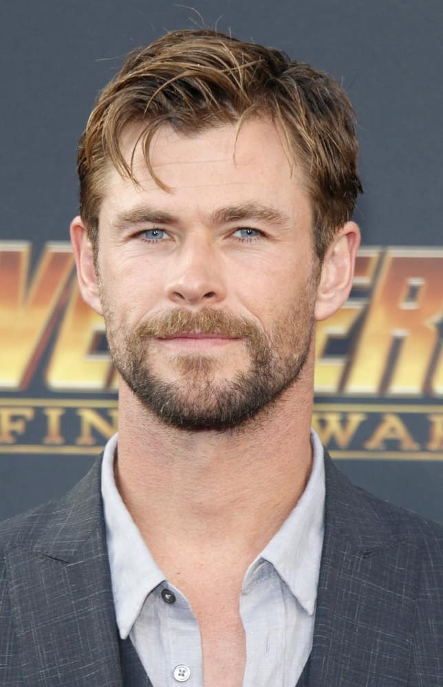 Chris Hemsworth attended the premiere of 'Avengers: Infinity War' held at the El Capitan Theatre in Hollywood, last April 23, 2018. His beard as well as his side-swept tousled hair were highlighted of the same caramel tone.