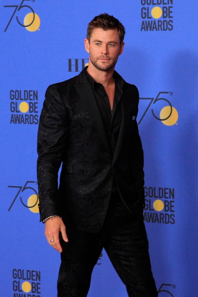Chris Hemsworth was spotted at the 75th Golden Globes Press Room at Beverly Hilton Hotel last January 7, 2018 in Beverly Hills. He sported a fashion forward black suit paired with a short and spiky crew cut hairstyle.