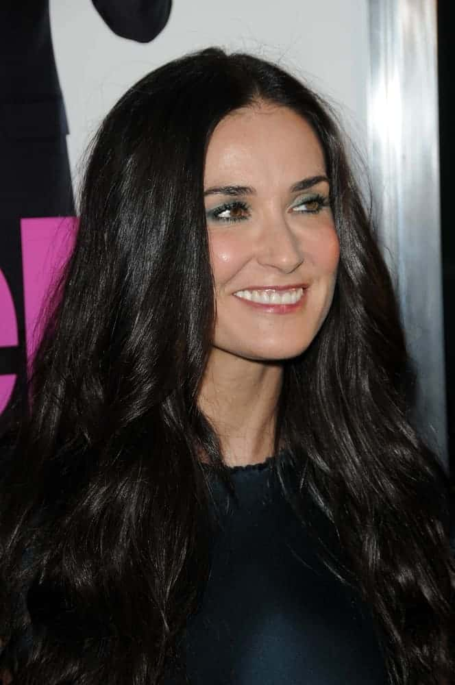 Demi Moore flaunted her thick and wavy hair in a center-parted style during the Los Angeles premiere of the movie
