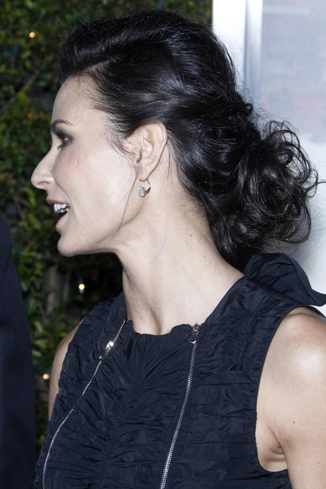 The actress sporting a glamorous updo hairstyle with a side braid and volumized slicked back on top. This was taken during the