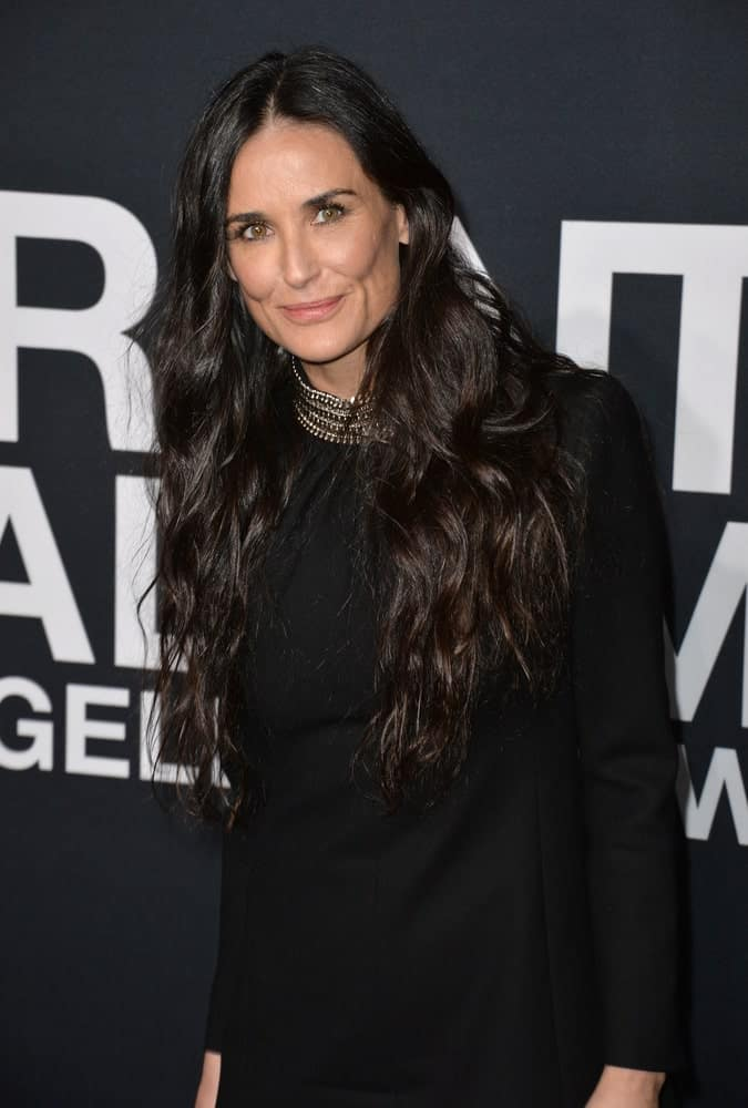 Last February 10, 2016, Demi Moore arrived at Saint Laurent at the Palladium fashion show at the Hollywood Palladium with a natural-looking permed hair and a classic black dress paired with a collared necklace.