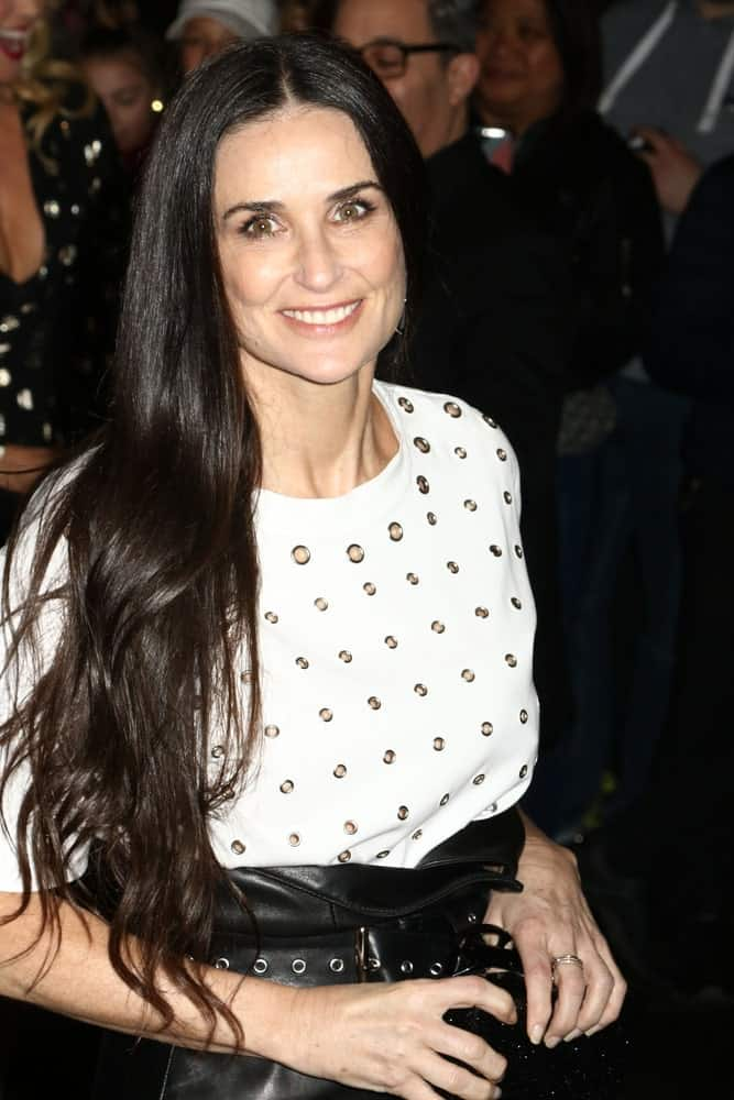 The actress is seen on April 19, 2017, in New York City flashing a sweet smile in a trendy getup along with her long black wavy hair that's tousled a bit.