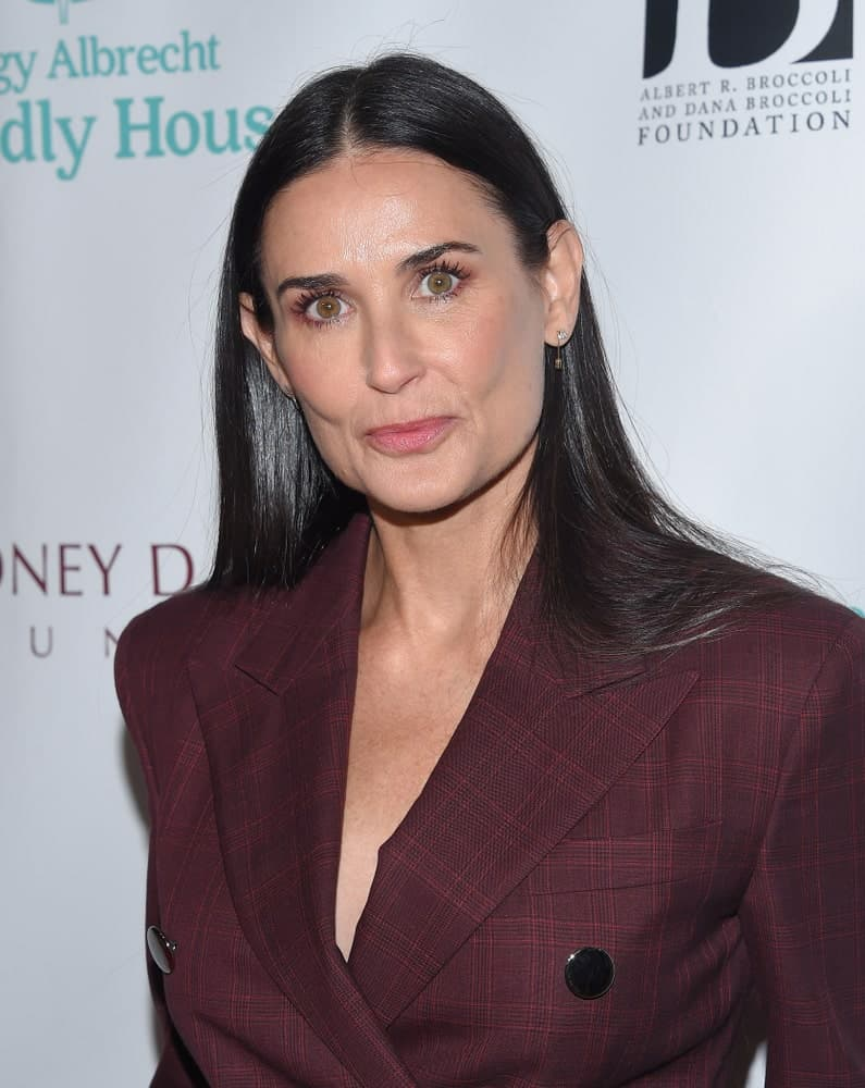 Demi Moore attended the Friendly House Lucheon on October 27, 2018, in Hollywood, CA with a classy burgundy plaid suit and a sleek black hair that's center-parted.