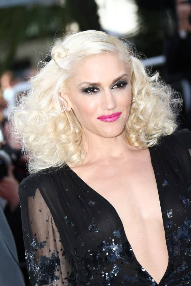 Gwen Stefani attended 'The Tree Of Life' premiere during the 64th Annual Cannes Film Festival at Palais des Festivals last May 16, 2011 in Cannes, France. She paired her gorgeous black sheer dress with a vintage curly blond hair.