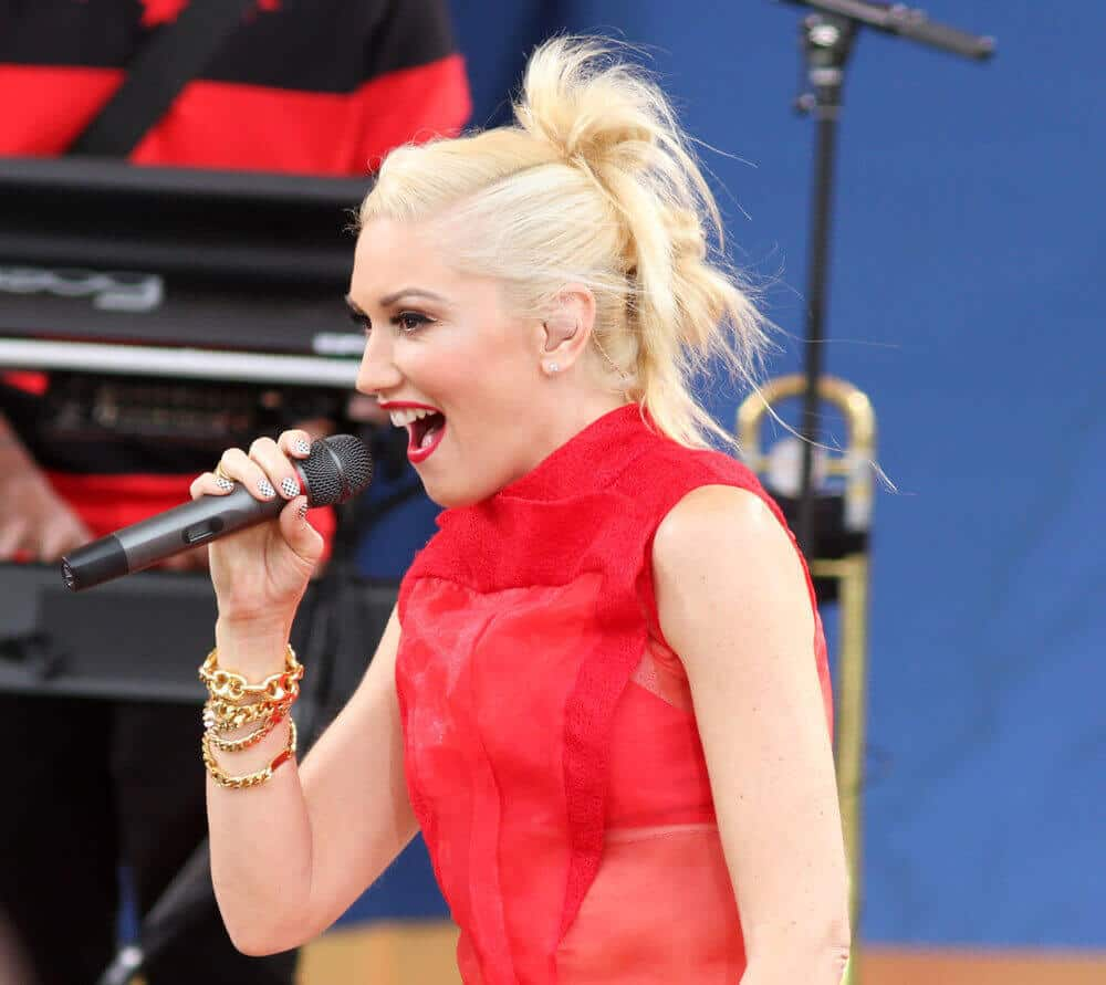 Gwen Stefani in multiple messy buns, performing live at Good Morning America in Central Park on July 27, 2012.