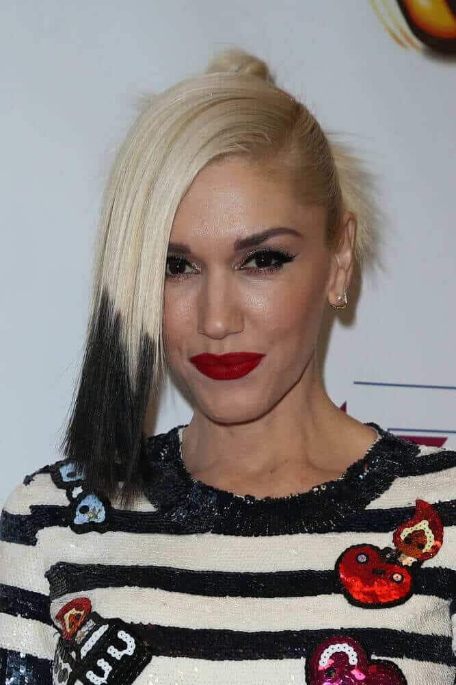 During the  Z100's Jingle Ball 2014 at Madison Square Garden on December 12, 2014, singer Gwen Stefani slayed the typical bun hairstyle with a side-swept partition dip-dyed in black.