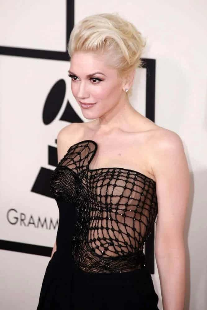 Gwen Stefani's platinum blond hair was styled into an elegant tousled upstyle during the Grammy Awards 2015 on February 8, 2015 in Los Angeles, CA.