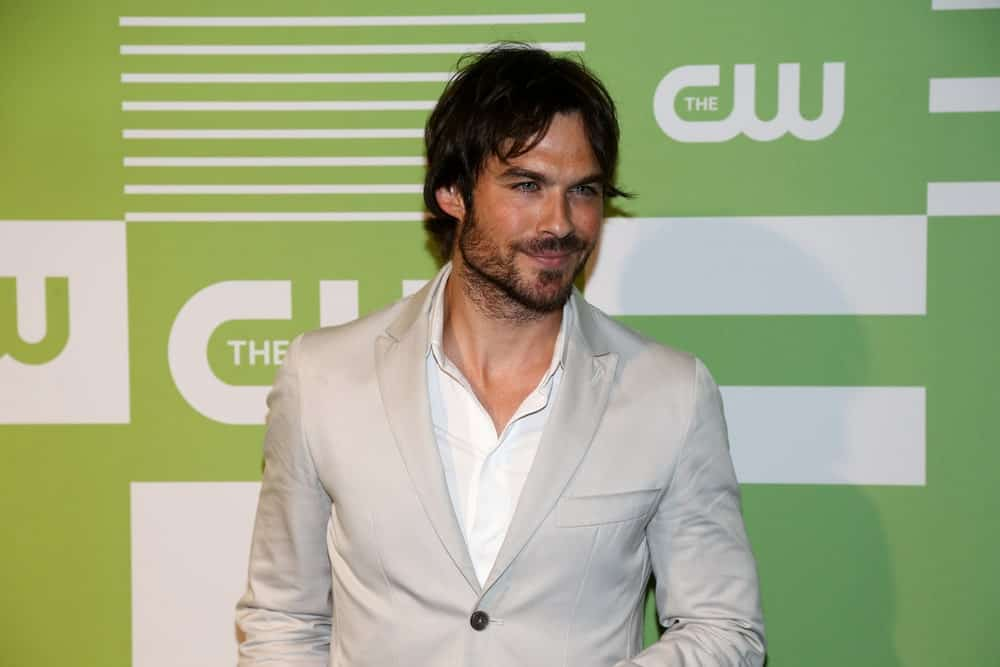 The actor attended the 2015 CW Network Upfront Presentation at the London Hotel on May 14, 2015, in a classic gray suit and a tousled hairstyle that goes perfectly with his beard.