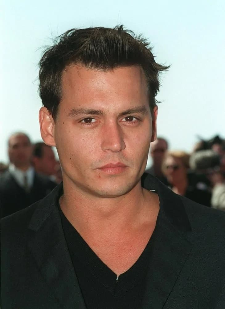 Fresh-faced Johnny Depp looked dashing in a short crew cut with a quiff that goes quite well with his clean-shave look during the 1997 Cannes Film Festival.