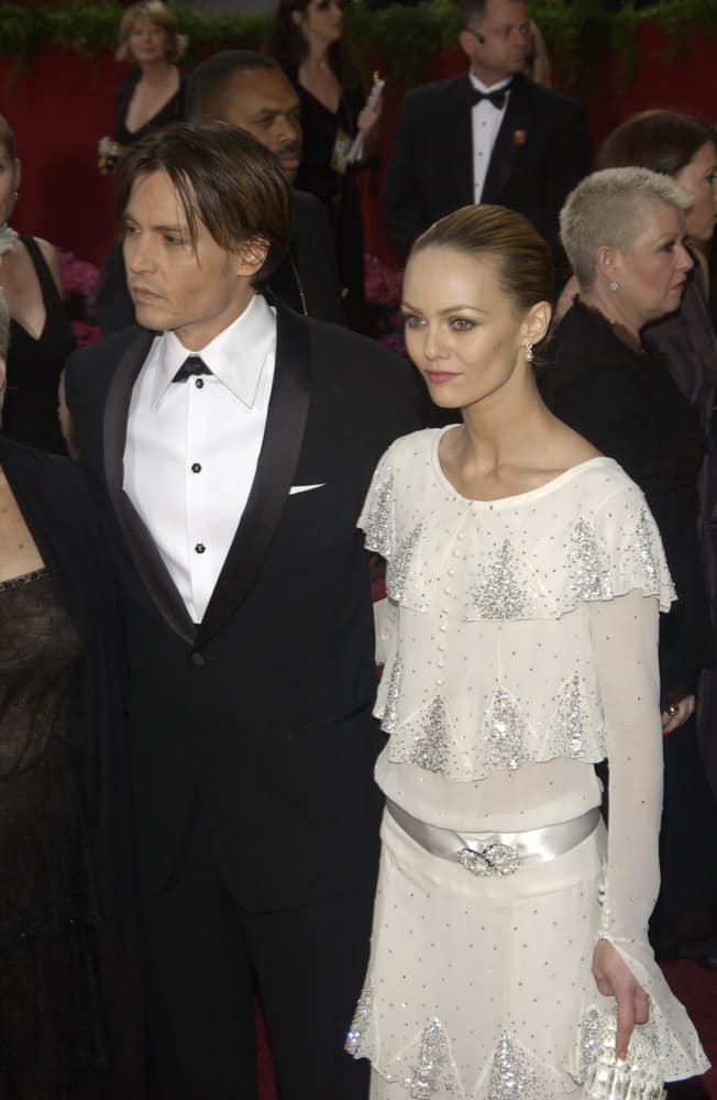 Johnny Depp & wife Vanessa Paradis attended the 76th Annual Academy Awards in Hollywood last February 29, 2004. Depp went with a long undercut hairstyle with highlights to pair with his black tuxedo.