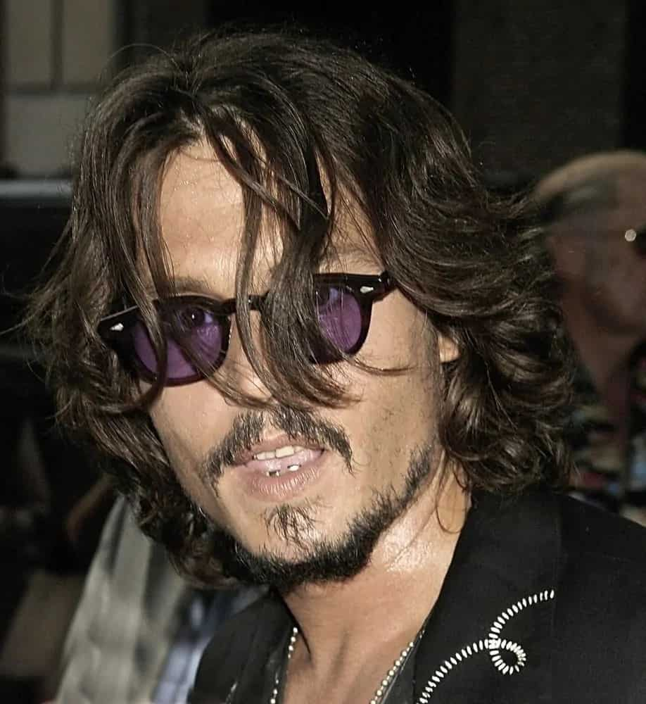 Johnny Depp went for a textured long and layered hairstyle at a talk show appearance for