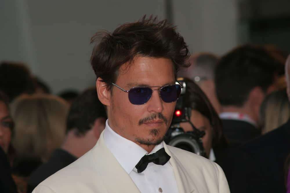 Johnny Depp attended the Tim Burton Golden Lion For Lifetime Achievement Award in Venice during the 64th Venice Film Festival last September 5, 2007 wearing an elegant white tuxedo and his short hair was tossed in a slight pompadour look.
