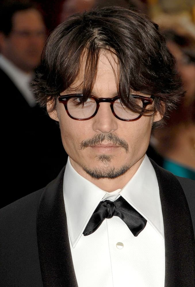 Johnny Depp was wearing a classy tuxedo with his messy and wavy hair with wispy bangs at the 80th Annual Academy Awards Oscars Ceremony, The Kodak Theatre in Los Angeles last February 24, 2008.
