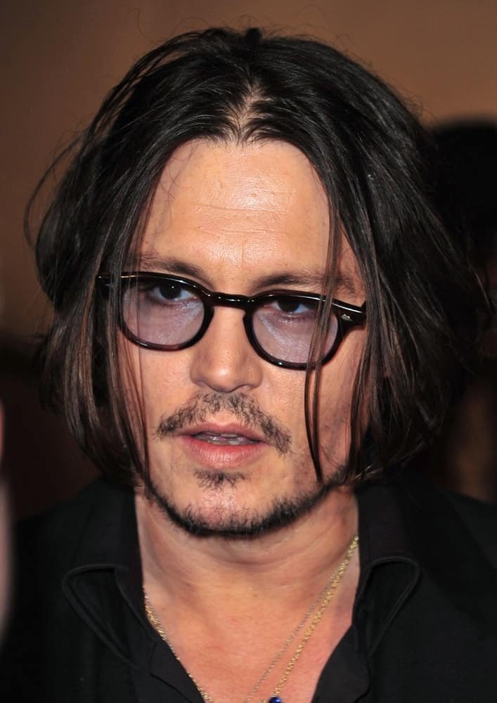 Johnny Depp was at The Museum of Modern Art Film Benefit A Tribute to TIM BURTON, MoMA Museum of Modern Art, New York last November 17, 2009. He wore a simple black outfit with his long center-parted raven hair.