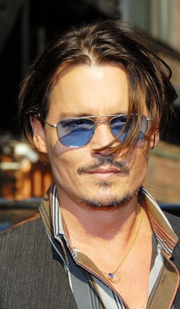 Johnny Depp was at The Late Show with David Letterman, Ed Sullivan Theater in New York last June 25, 2009. He went with his unique stylish fashion and long messy hair that has highlights at the tips.