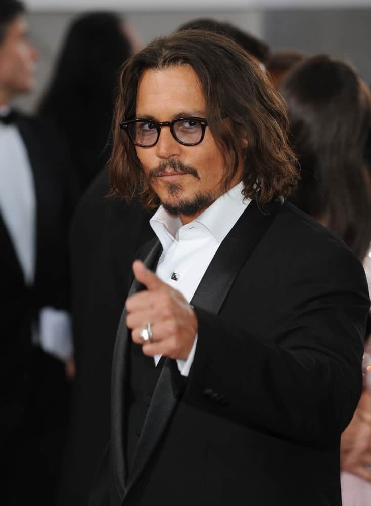Johnny Depp had shoulder-length wavy hair with highlights at the 68th Annual Golden Globe Awards on January 16, 2011 in Beverly Hills.