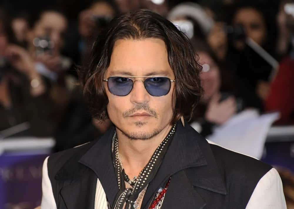 Johnny Depp exuded a rugged appeal with a stylish chin-length wavy bob hairstyle during the UK premiere of the