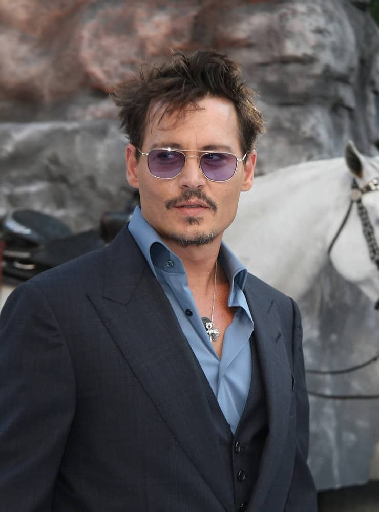 Johnny Depp and his stylish messy raven hair attended the premiere of The Lone Ranger at Odeon Leicester Square on Jul 21, 2013 in London.
