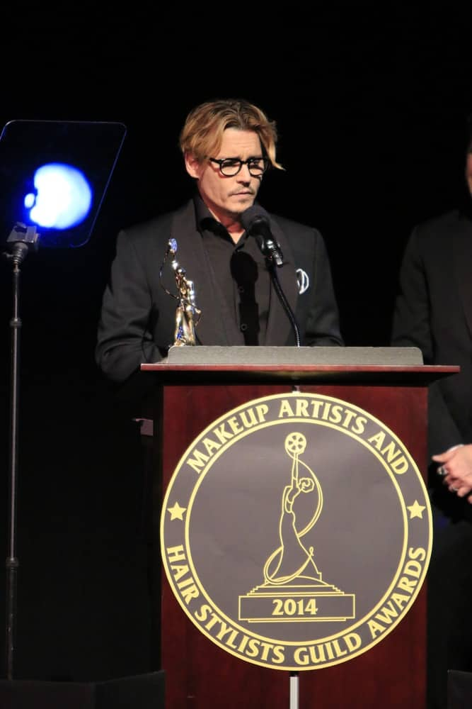 Johnny Depp had a reddish brown dyed hair that is center parted at the Annual Make-Up Artists And Hair Stylists Guild Awards at Paramount Theater on February 15, 2014 in Los Angeles.