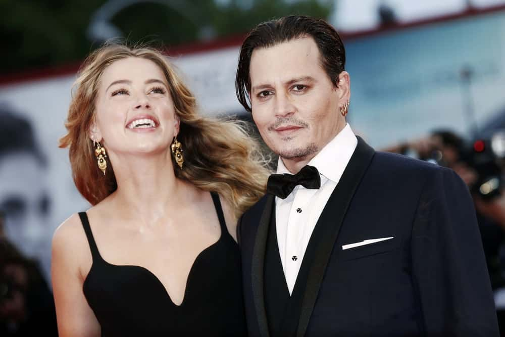 Johnny Depp and Amber Heard attended the September 4, 2015 'Black Mass' premiere in Venice, Italy. Depp went for a elegant and classic look with his long hair slicked neatly and five o'clock shadow.