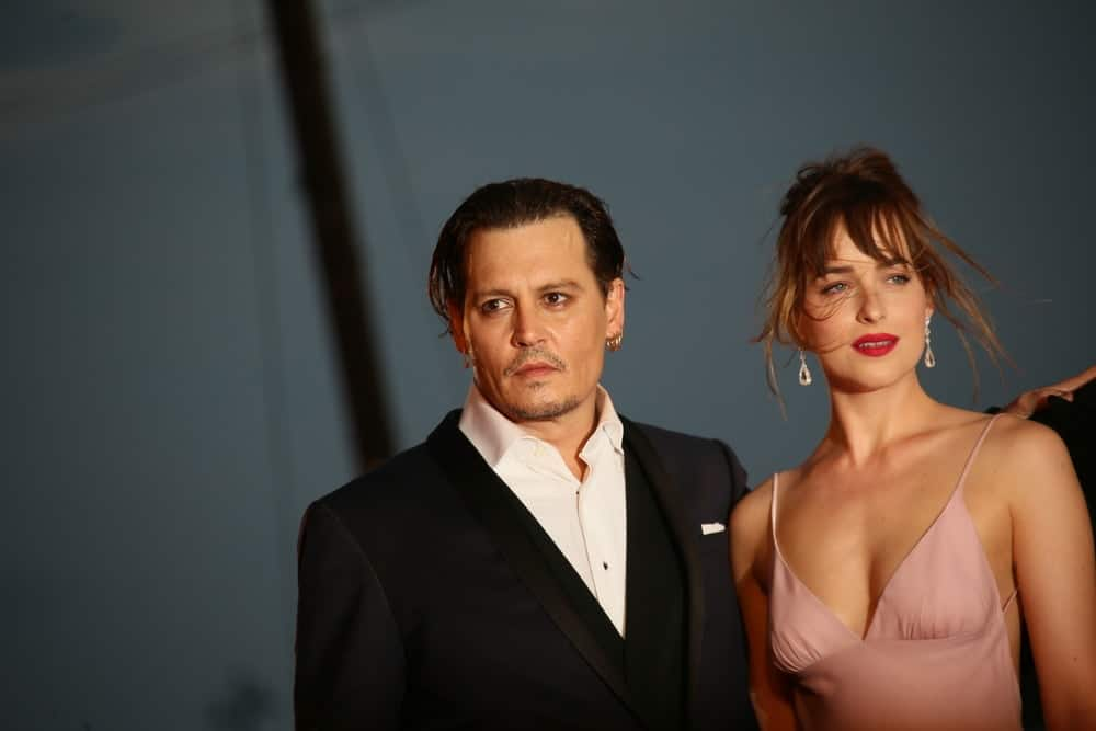 Johnny Depp and Dakota Johnson attended the premiere of the movie 'BLACK MASS' during the 72nd Venice Film Festival last September 4, 2015 in Venice, Italy. He opted for a vintage slicked back hairstyle to his long raven hair.
