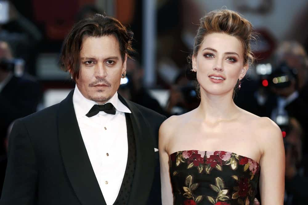 Johnny Depp and Amber Heard attend the premiere of 'THE DANISH GIRL' during the 72nd Venice Film Festival last September 5, 2015 in Venice, Italy. He looked dapper in his black suit that complements his reddish brown hair that was slightly tousled and highlighted.