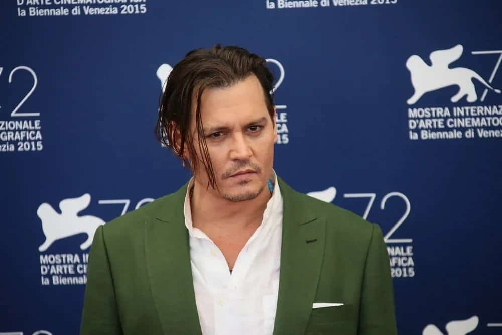 Johnny Depp was confident with his medium-length tousled slicked back hairstyle and some facial hair at the