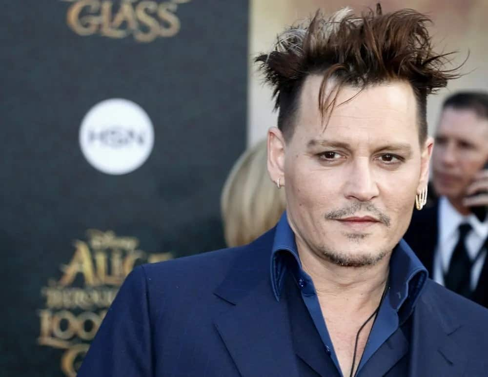 Johnny Depp's unique hairstyle had a lighter shade of hair color. It goes well with his for his tousled undercut hairstyle during the Los Angeles premiere of 'Alice Through The Looking Glass' held at the El Capitan Theater in Hollywood last May 23, 2016.