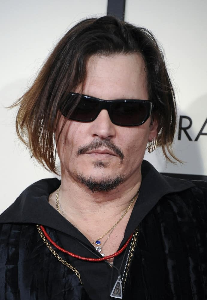 Johnny Depp attended the 58th Grammy Awards held at the Staples Center in Los Angeles, last February 15, 2016. His long undercut hair was highlighted and tousled loose that is a nice pairing for his facial hair.