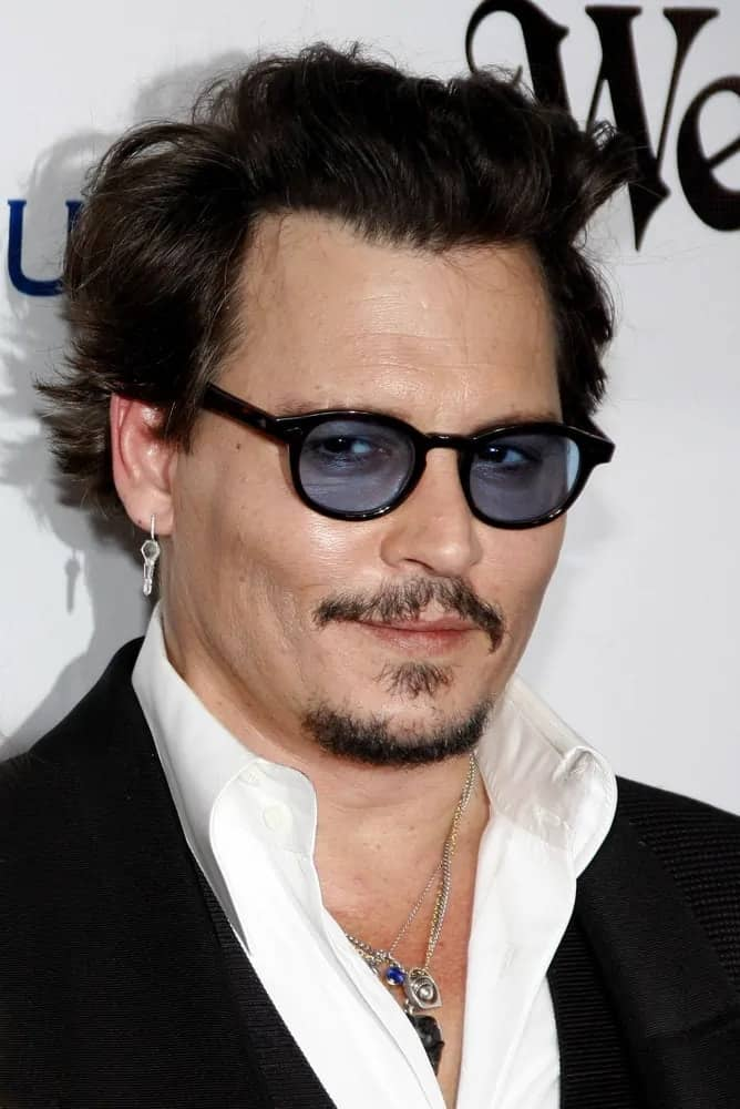 Johnny Depp opted for a tousled brushed up flippy hairstyle that goes quite well with hisblack suit when he attended the Art Of Elysium's 9th Annual Heaven Gala held at the 3LABS in Culver City last January 9, 2016.
