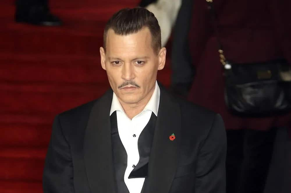 Johnny Depp sported a vintage classic look with this slicked back undercut hairstyle at the London premiere of his film