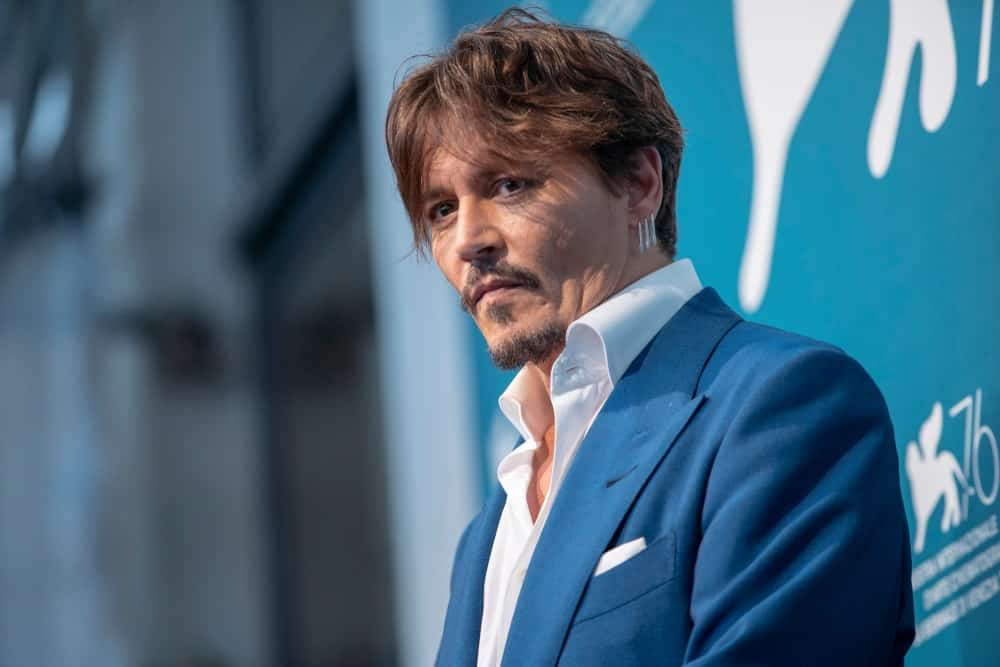 Johnny Depp attended the photocall for the film ''Waiting for the Barbarians'' presented in the 76th Venice Film Festival at Venice Lido last September 6, 2019. He wore a simple blue suit with his tousled reddish brown hair.