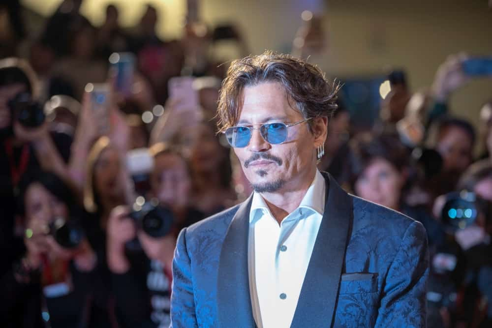 Johnny Depp was at the ''Waiting For The Barbarians'' screening during the 76th Venice Film Festival at Sala Grande last September 06, 2019 in Venice, Italy. His elegant detailed blue suit goes well with his reddish brown tousled and flipped hair.