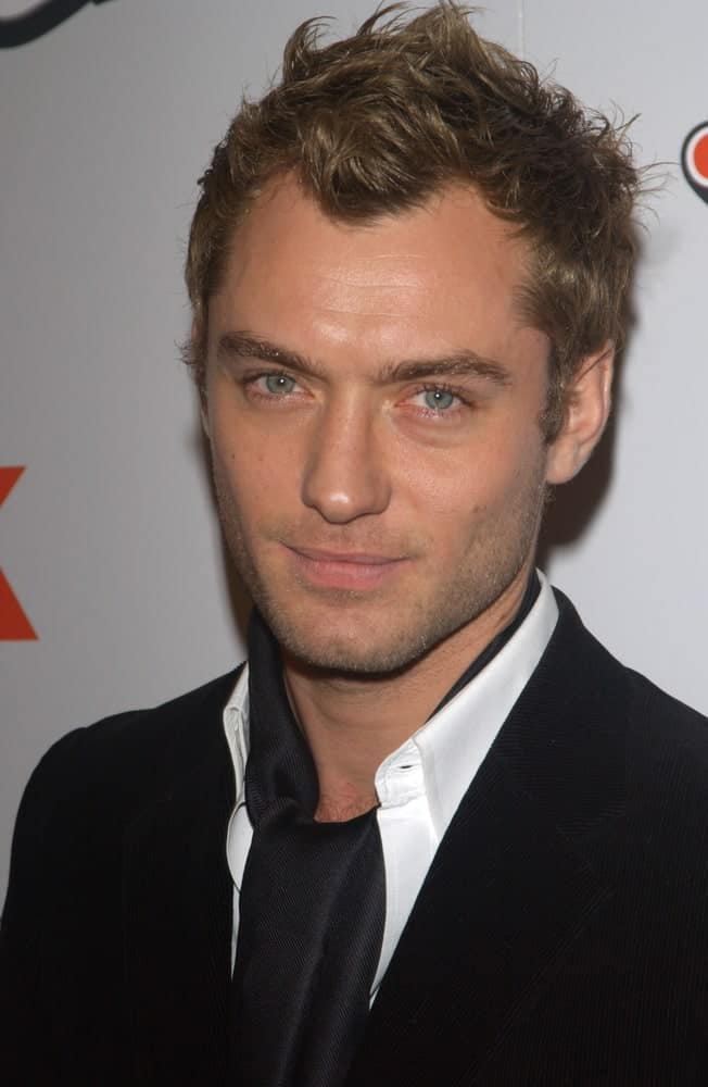 Actor Jude Law showcased his bright green eyes and short tousled brown hairstyle at the Los Angeles premiere of his new movie Cold Mountain last December 7, 2003.