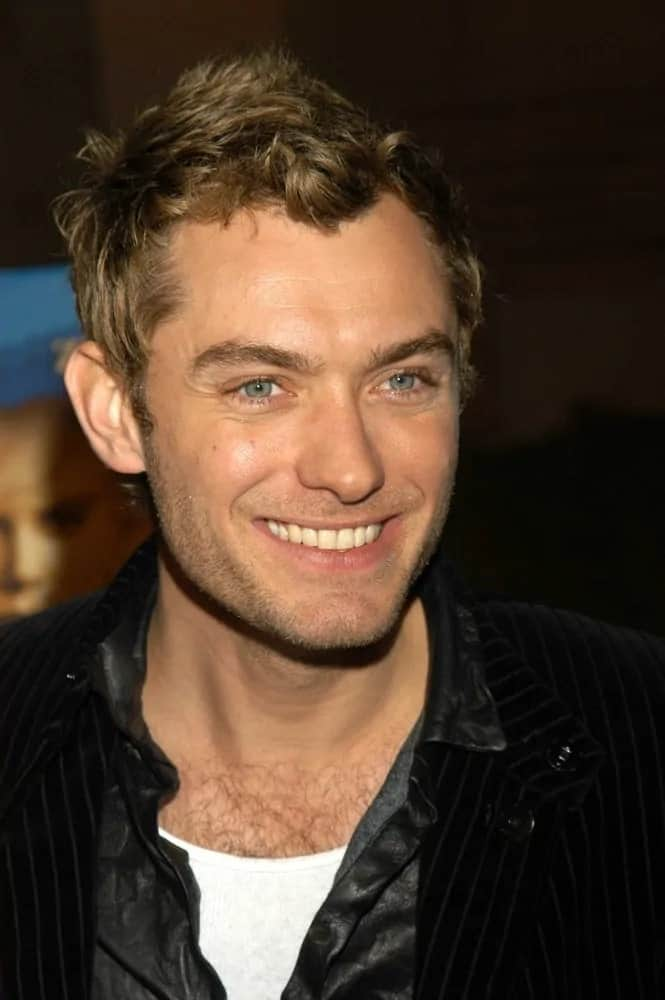 Jude Law sported a short brown haircut with a sort of messy quiff when he attended the celebration of the words and music of